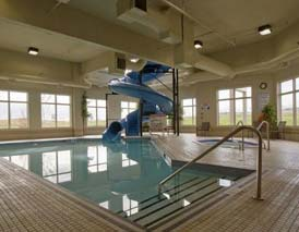 waterslide, pool & hot tub for fun or relaxation at Dawson Creek in Stonebridge